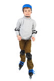 Boy in helmet smiling and rollerblading isolated Royalty Free Stock Images