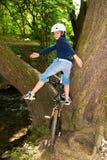 Boy with helmet strikes a pose on his mountain bike Stock Image