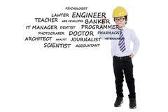 Boy with helmet writes his dream jobs Stock Image