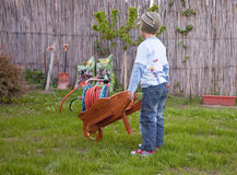 Boy helping gardening Royalty Free Stock Photos