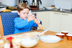 Boy helping at kitchen Stock Photography