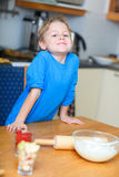 Boy helping at kitchen Stock Photos