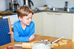 Boy helping at kitchen Royalty Free Stock Photography
