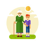 Boy helping old lady Stock Image