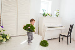 Boy helping to clean up toys royalty-vrije stock foto