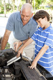Boy Helps Dad Stock Image