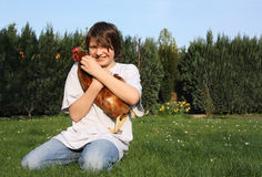 Boy with hen. Hahn and hens on a meadow Royalty Free Stock Photos