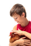 The boy with the hen Stock Photo
