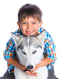 Boy with her dog husky Stock Images