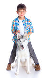 Boy with her dog husky Stock Photo