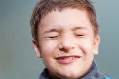 Boy with her eyes closed. This image has attached release royalty free stock photography