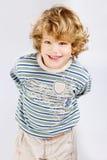 Boy hidening something Royalty Free Stock Images