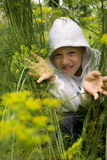 Boy hiding. In the grass Stock Photo