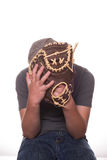 Boy hiding behind baseball glove Stock Photography