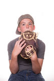 Boy hiding behind baseball glove. Boy with his mouth hidden by a baseball glove royalty free stock images