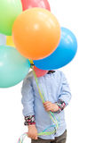 Boy hiding behind a bunch of balloons isolated on white background. Stock Photo