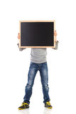 Boy hiding face behind blackboard Royalty Free Stock Photos