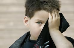 Boy hiding his face Stock Photos