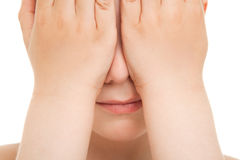Boy hiding his face close up Royalty Free Stock Photography