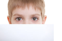 Boy hiding over sheet of paper Royalty Free Stock Photo