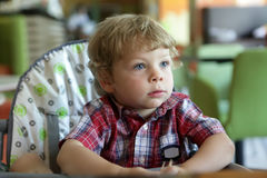 Boy in highchair Stock Photo