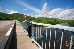 Boy hiker standing on the bridge. Royalty Free Stock Photos