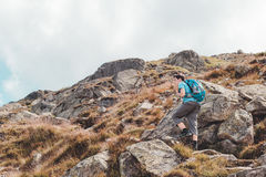 Boy hiking alone in the mountains Royalty Free Stock Images