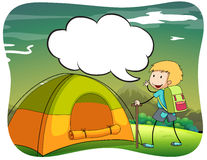 Boy hiking and camping out Stock Photo