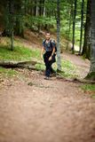 Boy hiking in a mountain forest Royalty Free Stock Photo