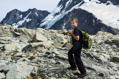 Boy hiking in mountains Stock Photography