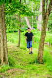 Boy Hiking walking toward you. An 11 year old boy hiking on a trail Stock Photos