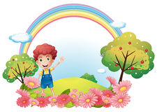A boy at the hill with a rainbow Royalty Free Stock Photography