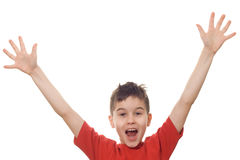 Boy with his arms in the air. Letting out a victory yell royalty free stock photo