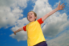 Boy with his arms wide open Stock Image