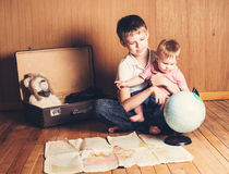Boy with his baby sister preparing for the journey. Brother hold Stock Images