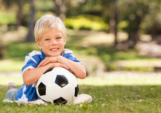 Boy with his ball in the park Royalty Free Stock Images