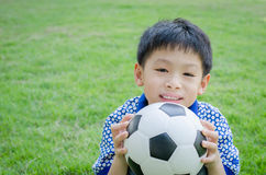 Boy with his ball in the park Royalty Free Stock Photography