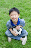 Boy with his ball in the park Royalty Free Stock Photos