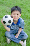 Boy with his ball in the park Stock Images