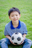 Boy with his ball in the park Royalty Free Stock Image