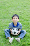 Boy with his ball in the park Royalty Free Stock Photo