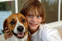 Boy and his big dog. A boy snuggling with his big dog royalty free stock photography