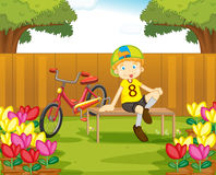 Boy and his bike in the garden Stock Images