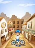 A boy and his bike near the saloon bar Royalty Free Stock Photography
