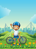 A boy and his bike standing across the tall mountains Royalty Free Stock Images