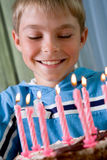 Boy in his birthday. In party in hats, pie with candles Royalty Free Stock Image
