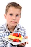 Boy and his birthday cheesecake Royalty Free Stock Photography