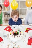 Boy at his birthday party Royalty Free Stock Photo