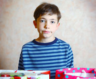 Boy with his birthday presents. And toys Royalty Free Stock Photos