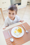 Boy and his breakfast Stock Image